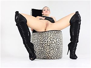 Dahlia Wears thigh High boots And Plays With Her pussy