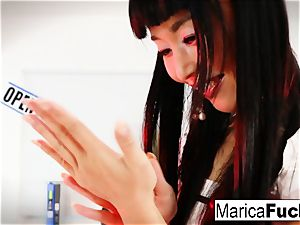 Marica Hase uses a glass plaything