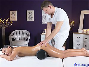 Exotic oiled babe gets orgasmic massage session