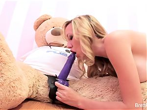 Brett Rossi plays with a plunged bear's strap-on dildo