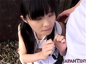 puny japanese woman outside making sweet love