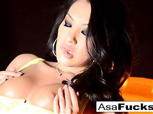 Asa Akira shows Off Her amazing assets