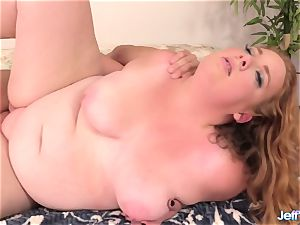 gorgeous plumper Ginger Rose pleased with a hefty chisel in Her jaws and cunny