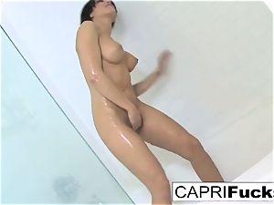 Capri loves to finger her tight puss
