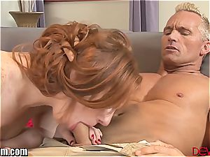 Ginger with a shaved pussy salutes ample rod inside