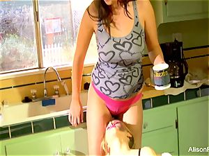 Alison Tyler and Katie Summers poke in the kitchen